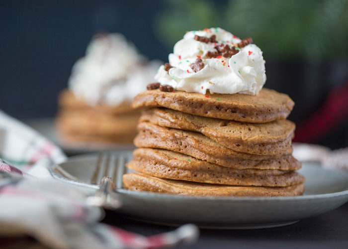 Fluffy pancakes get the gingerbread treatment! Brown sugar, molasses, cinnamon, ginger ... yum. Top with whipped cream and cinnamon for the perfect breakfast treat! Top with whipped cream and cinnamon for the perfect breakfast treat! With dairy-free option. #gingerbreadpancakes #christmasbreakfast
