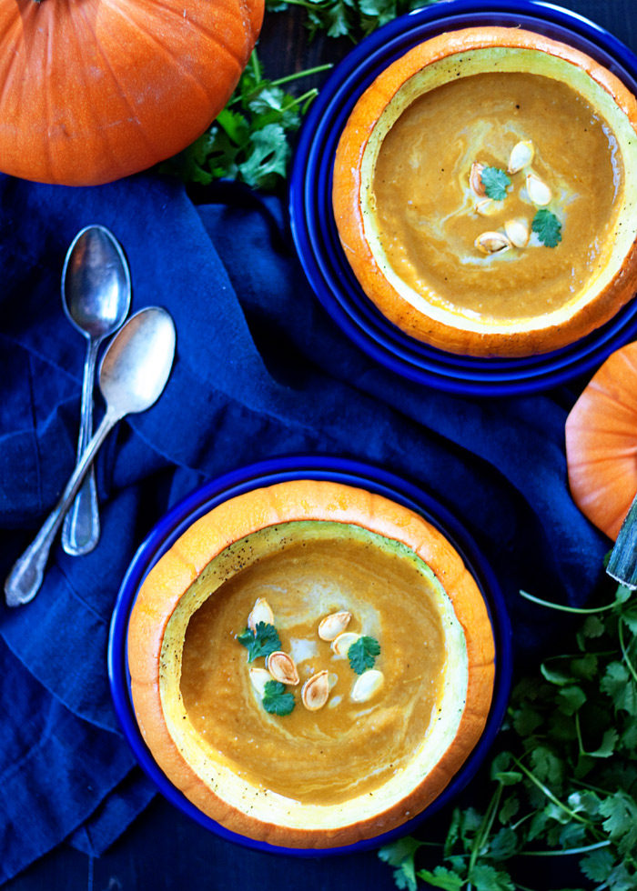 Pumpkin Curry Soup recipe - Pumpkin puree, apples, onions, and warm, earthy spices are blended together to create a pot of creamy, delicious pumpkin love! This one is made with pumpkin puree, so you can enjoy it any time of year - not just fall. Vegetarian with vegan option.