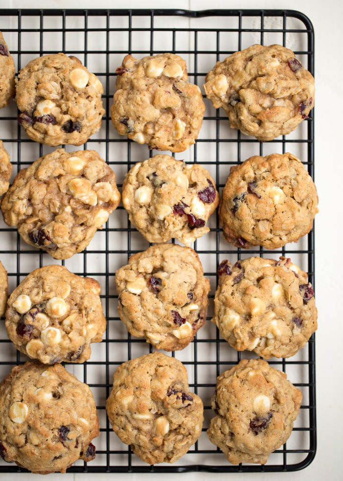 Tender, buttery oatmeal cookies packed with melty white chocolate chips and tart dried cranberries. Perfect for the holidays but a favorite year-round cookie too!