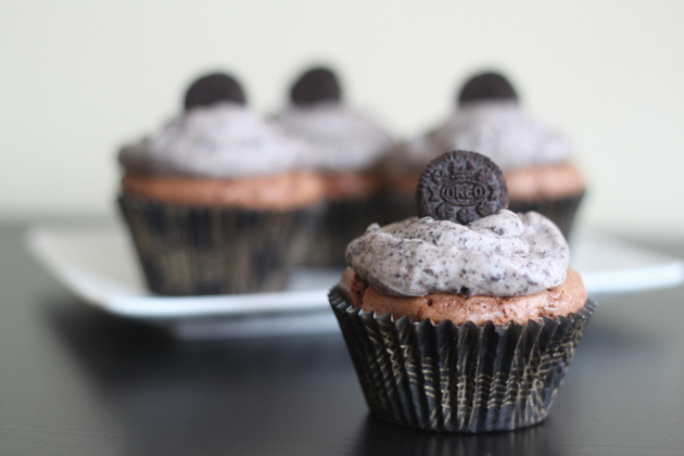 Cookies & Cream Oreo Brownie Cupcakes - Super-easy one-bowl brownie cupcakes with an Oreo cookie baked right in the middle, then topped off with a fluffy cookies-and-cream buttercream.