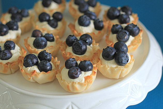 No-Bake Blueberry Cheesecake Mini Tarts dessert appetizer recipe - Less than 10 minutes to make! These two-bite tarts are ideal for entertaining - they're perfect finger food and they impress everyone.