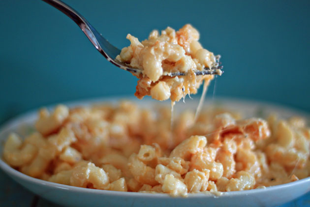 The Best Macaroni and Cheese Recipe Ever - Seriously. Creamy, cheesy, straightforward, ooey, gooey - this macaroni and cheese will knock your socks off.