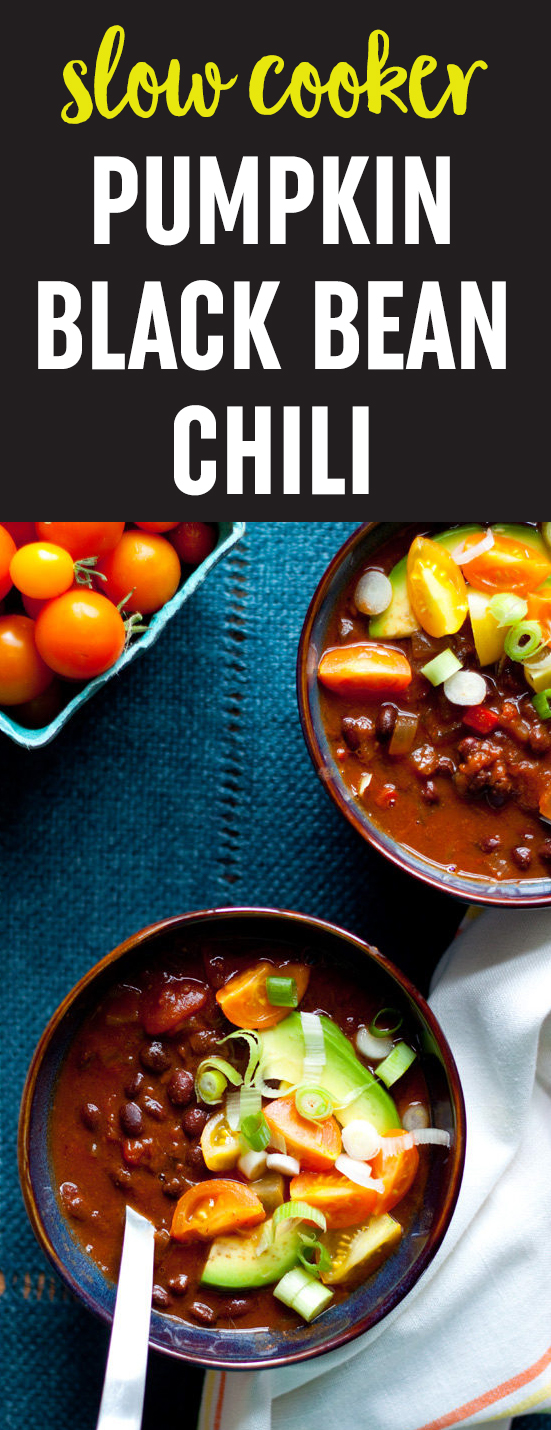Black beans, pumpkin, and warming spices simmer together in your Crock Pot to make a meatless pumpkin chili recipe that's perfect for fall. #veganchili #vegetarianchili #pumpkinchili