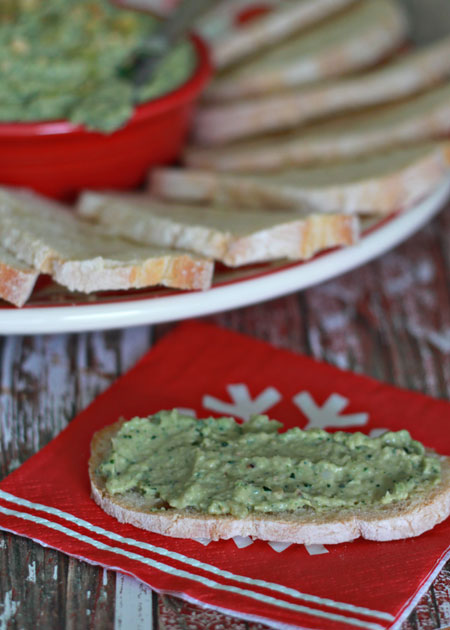Creamy White Bean & Kale Pesto Dip recipe - This addicting garlicky dip is the perfect way to sneak in a superfood.