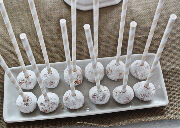 """Lazy """"cake pops"""" made with donut holes & striped paper straws 
