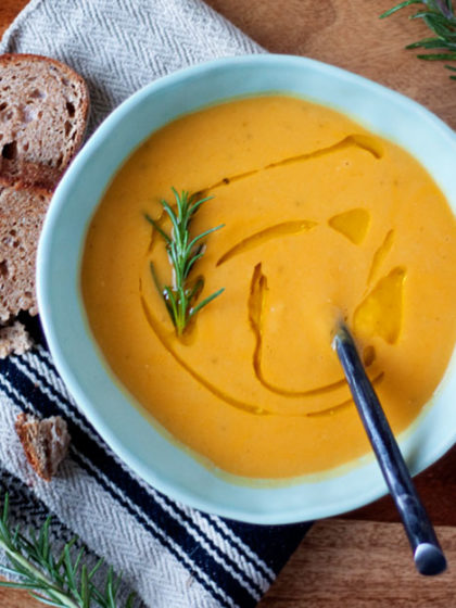 Creamy Sweet Potato Rosemary Soup recipe - Fresh rosemary and creamy sweet potatoes unite happily in this super-simple (yet super-scrumptious) soup. (Vegetarian with vegan option)