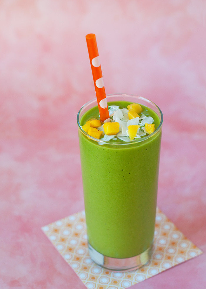 Vegan Mango-Coconut Green Smoothie recipe - With its light coconut milk base (no dairy here) this tropical vegan green smoothie is utterly creamy and coconutty. Tastes like a day at the beach!