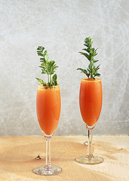 Carrot Mimosas recipe - Carrot juice and Prosecco combine to make these cute, kitschy mimosas that couldn't be more perfect for Easter.