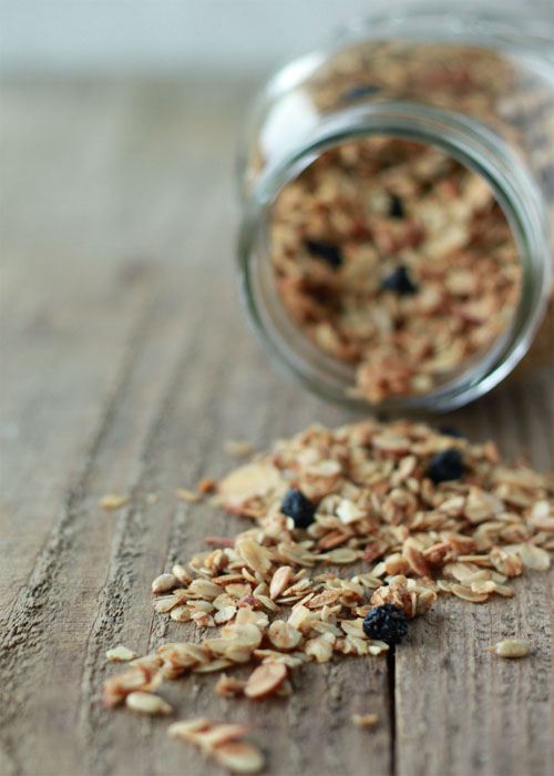How to Make Granola - An easy how-to and formula for homemade granola! Customize however you like for your very own version. (It's so, so, so much cheaper to make it at home than buy it in the store, too!) Dairy-free/vegan and no refined sugar options included