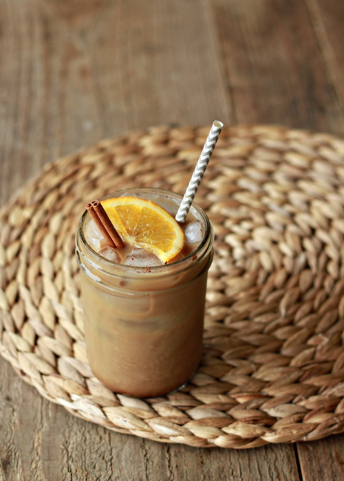 Orange Spice Iced Coffee recipe. Homemade orange simple syrup - spiked with cinnamon, cloves, and nutmeg - mix with cold brew and ice for a swirl of creamy, caffeine-packed, entirely-too drinkable goodness.