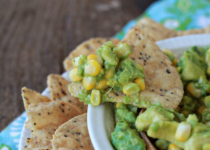 Sweet Corn Guacamole - Cool, chunky avocado meets sweet corn in this simple and sassy summer guacamole recipe.