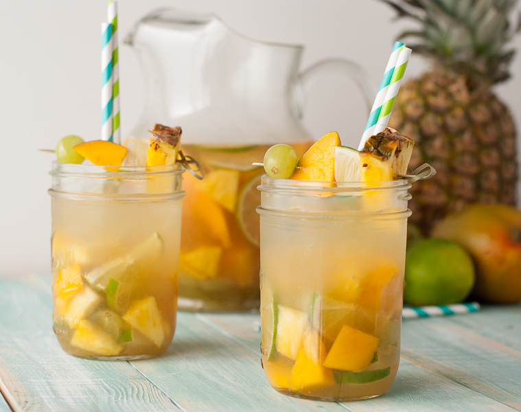 Tropical Passion Sangria by Pineapple and Coconut // 50 Sensational Summer Sangria Recipes | Kitchen Treaty