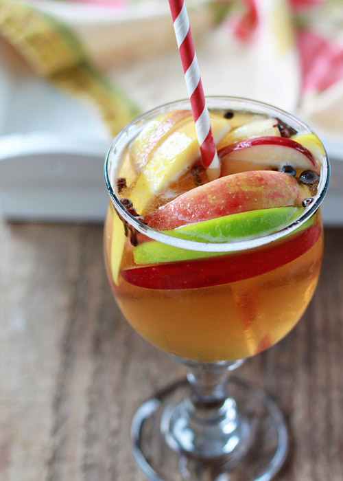 Spiced Apple Cider Sangria - his sweet spiced apple sangria is nice and light, a little bubbly, a tad sweet, and an absolutely perfect excuse to celebrate the season.