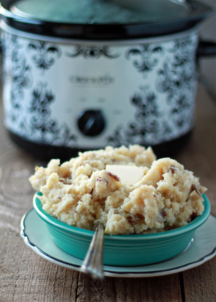 Unbelievably Easy Crock Pot Garlic Mashed Potatoes recipe - With just five minutes of hands-on time, these garlicky slow cooker mashed potatoes are the easiest I've ever made.