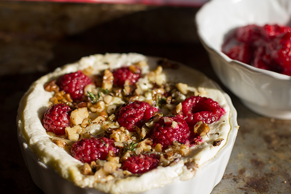Baked Goat Cheese with Raspberries & Thyme from The Tomato Tart || 40 Uber Cheesy Dip Recipes (P.S. They're all meatless, too!) | kitchentreaty.com