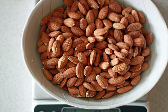 How to make homemade almond butter. All it takes are almonds - and a pinch of salt if you like! Delicious, nutritious, rich, incredible almond butter. Seriously, you guys - it's so easy!
