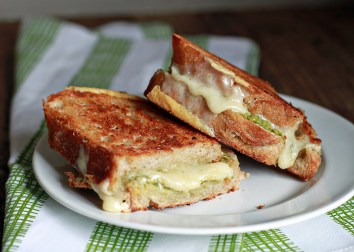 Artichoke Arugula Pesto Grilled Cheese recipe - Creamy artichoke-arugula pesto + sharp cheddar = melty deliciousness.