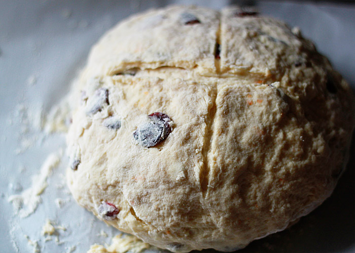 Cranberry Orange Irish Soda Bread recipe - Crusty, buttery, and full of flavor with flecks of orange zest and ruby dried cranberries. This Irish Soda Bread might not be the most traditional version ever created, but it is quite possibly the most delicious!