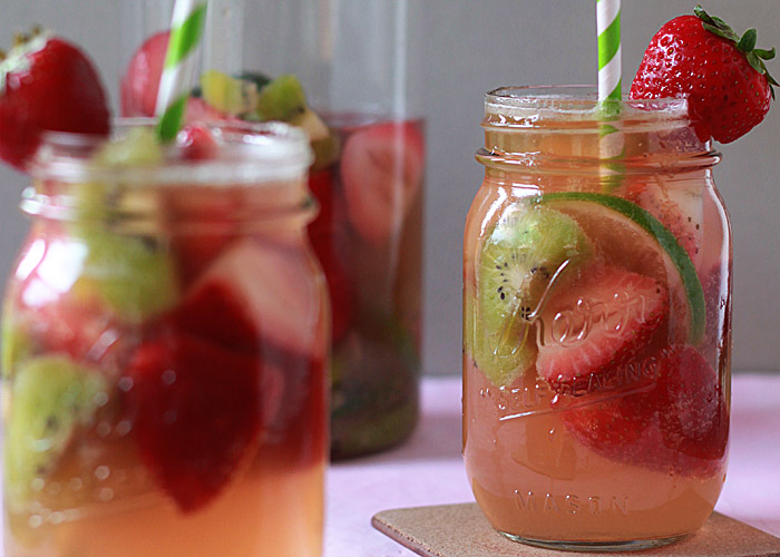 White Strawberry-Kiwi Sangria - Juicy strawberries, sweet kiwi, light white wine, and rum. So perfect for hot days!