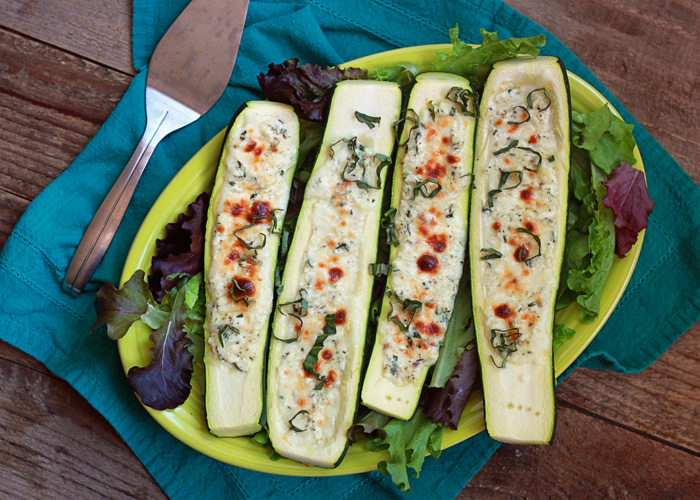 White Pizza Stuffed Zucchini Boats recipe - Garlic, herbs, ricotta, and melty mozzarella stuffed inside tender zucchini. White pizza - sans crust - for the win! Vegetarian.