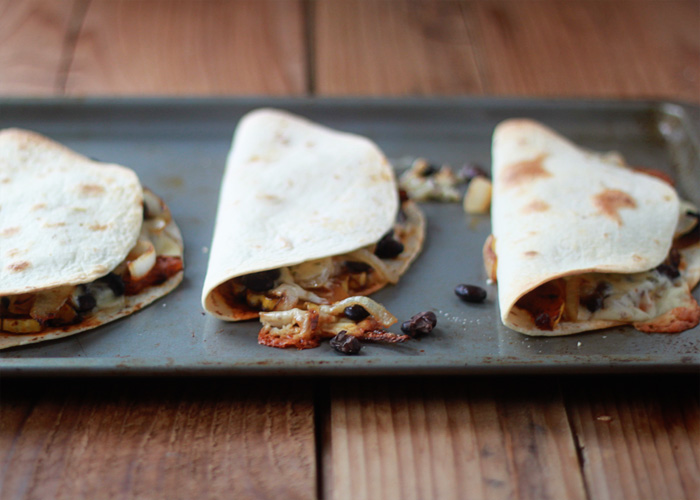 Smoky Delicata Squash & Black Bean Baked Quesadillas - Spicy seared delicata squash, blackened onions, black beans, and pepper jack, tucked inside a tortilla and baked until melty and golden. Serve with a little pico de gallo or fresh tomato slices and dinner's made!