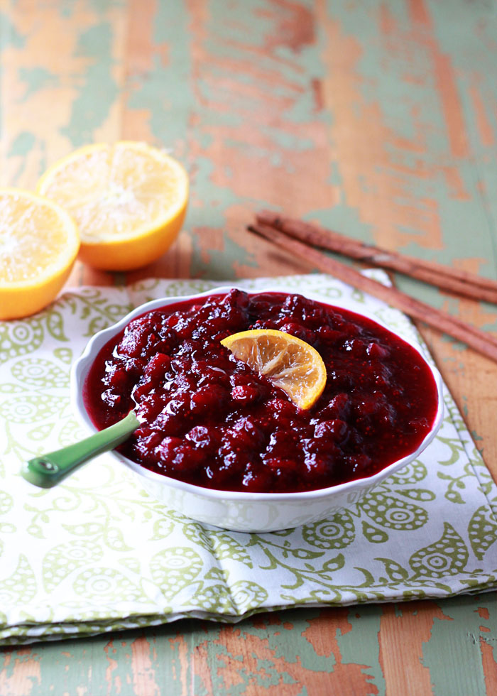 Orange Maple Cranberry Sauce - This easy homemade cranberry sauce recipe is sweetened with pure maple syrup instead of refined sugar. Orange and cinnamon lend subtle seasonal flavor without taking over. Make now and freeze for Thanksgiving!