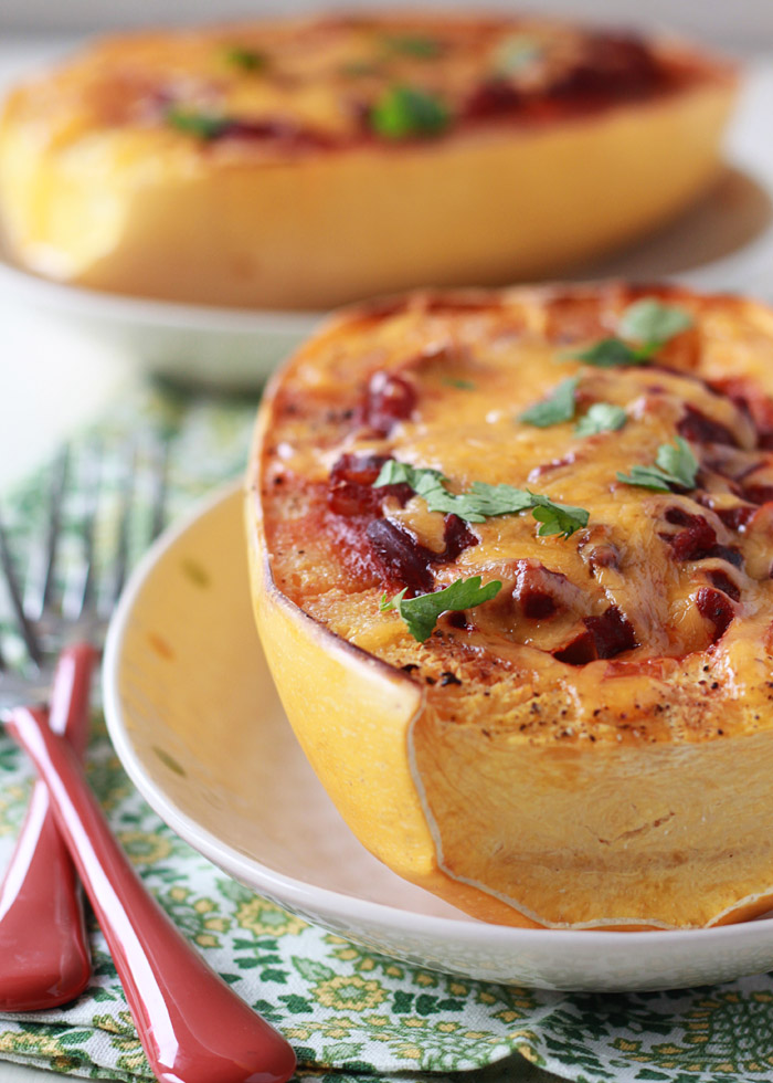 Chili Cheese Stuffed Spaghetti Squash - Melty cheddar and tangy chili make this a squash for squash haters. Who can turn down chili and cheese?! Make it your own by using any chili you want (perfect for leftovers!)