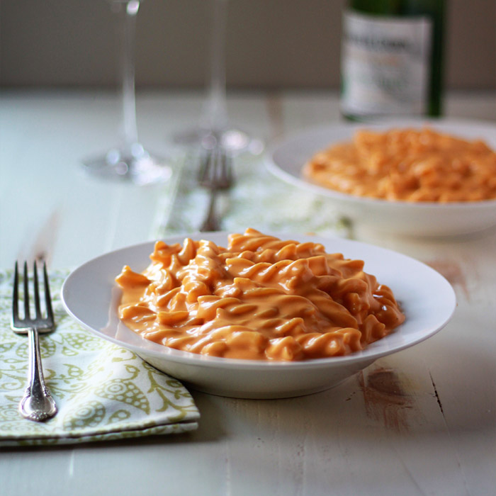 Stove-Top Butternut Squash Mac and Cheese - Tender pasta generously slathered in quite possibly the most rich, velvety, and creamy cheese sauce you've ever encountered. And it's ready in under 30 minutes!