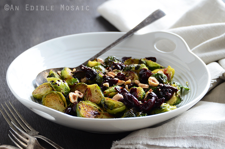 127 Vegetarian Thanksgiving Recipes Everyone Will Love - Caramelized Brussels Sprouts with Dark Cherry Sauce & Hazelnuts from An Edible Mosaic