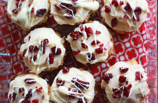 Cranberry Bliss Muffins - Inspired by the famous Starbucks bars, these cream-cheese frosted muffins are studded with cranberries and white chocolate. The perfect breakfast treat for the holidays!