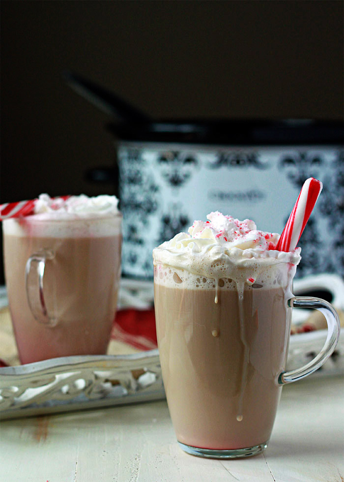 Slow Cooker Peppermint Vanilla Lattes - An easy Crock Pot latte recipe with festive mint and warm vanilla flavors. Stir it all together and come back two hours later to a coffee shop in your kitchen! (We love these on Christmas morning!)
