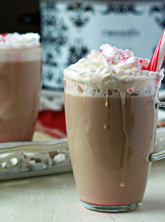 Slow Cooker Peppermint Vanilla Lattes - An easy Crock Pot latte recipe with festive mint and warm vanilla flavors. Stir it all together and come back two hour later to a coffee shop in your kitchen! (We love these on Christmas morning!)