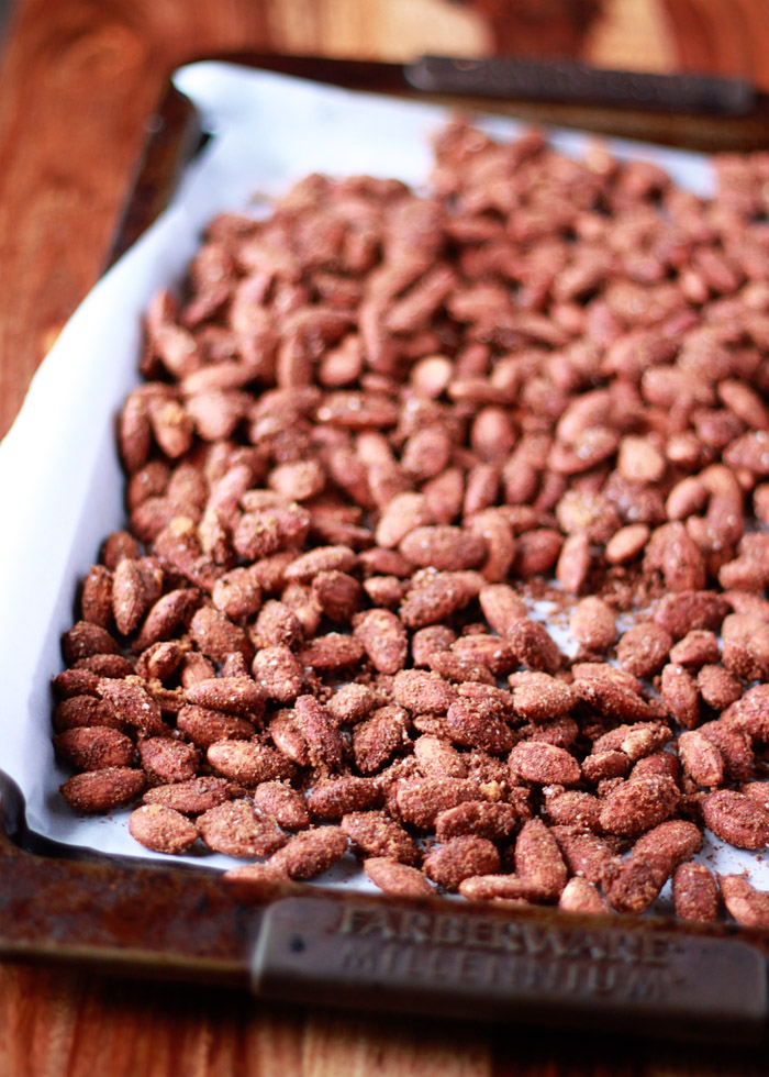 Moroccan Spiced Almonds - Sweet, salty, and spicy. These easy roasted nuts are coated with Moroccan-inspired spices and roasted until crunchy and addicting. We love these with a nice light white wine! Perfect for gifting ... or keeping.