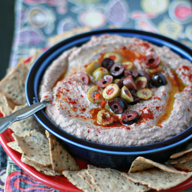 Salty kalamatas and pimento-stuffed green olives lend a little pizzazz to plain ol' hummus.