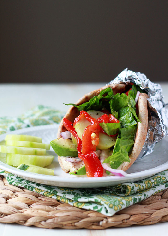 Vegan Hummus, Roasted Red Pepper, & Avocado Gyros recipe - Creamy hummus and smoky roasted red peppers make for a scrumptious vegan gyro.