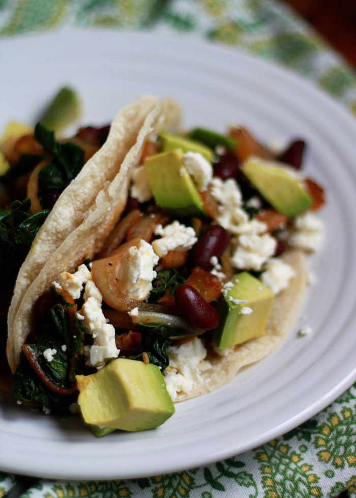 Beans and Greens Tacos recipe. With kidney beans & rainbow chard, these tacos are fast, easy, and healthy - the perfect weeknight meal. Flexible for meat-eaters, vegans, vegetarians & gluten-free diets.