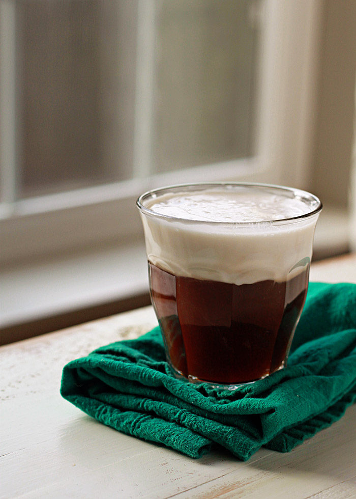 Vegan Irish Coffee recipe - Fluffy coconut whipped cream floats atop whiskey-spiked coffee for this vegan riff on the classic cocktail.