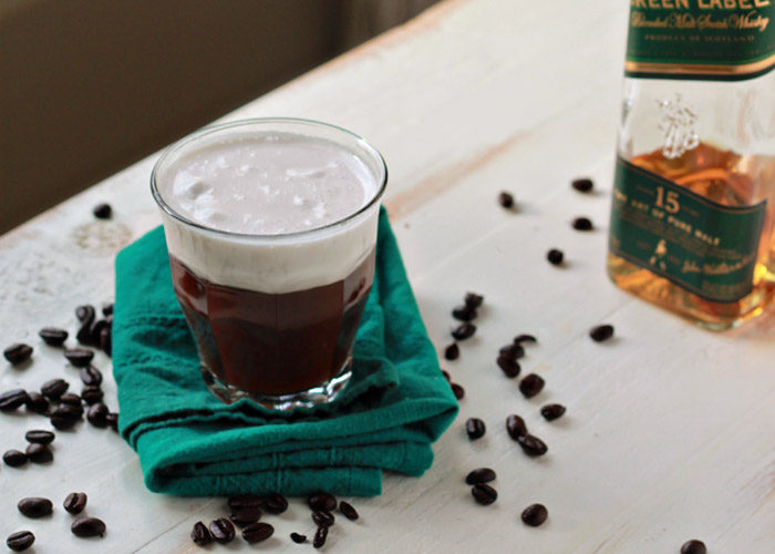 Vegan Irish Coffee recipe - Fluffy coconut whipped cream floats atop whiskey-spiked coffee for this dairy-free riff on the belly-warming classic.  Perfect St. Patrick's Day cocktail!