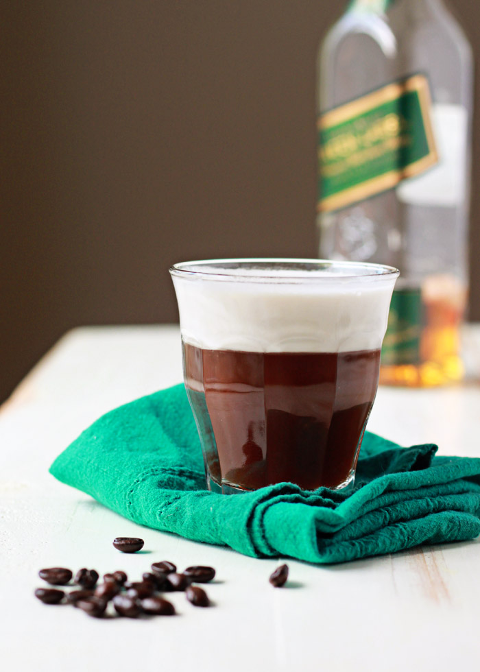 Vegan Irish Coffee recipe - Creamy coconut whipped cream floats dreamily atop spiked whiskey-spiked coffee for this vegan version of the classic cocktail.