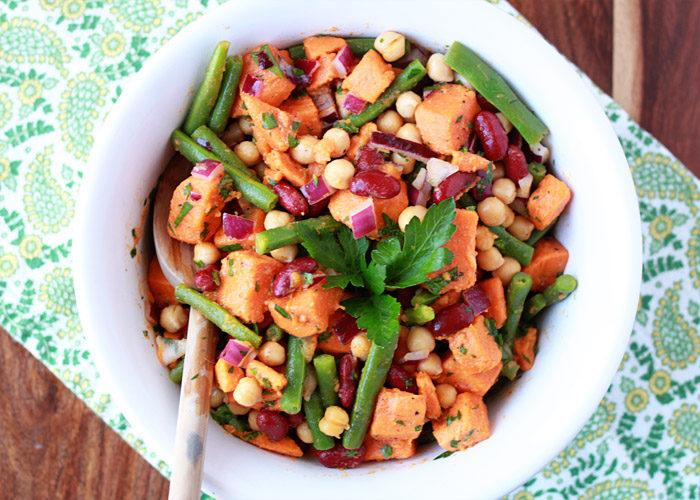 Three Bean Sweet Potato Salad recipe - This riff on retro three-bean salad adds sweet potatoes to the mix. We love this hearty twist on potato salad - perfect for potlucks, too.