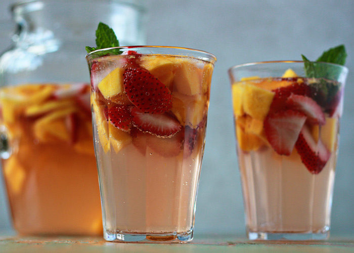 White Strawberry-Mango Sangria - A light, refreshing, and just plain luscious sangria. Perfect for hot summer days!