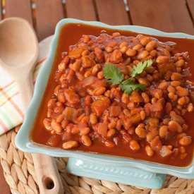 """Slow Cooker Mango BBQ Baked Beans - Tangy, saucy, and savory-sweet, these easy (and vegan!) Crock Pot beans practically scream """"summer barbecue!"""""""