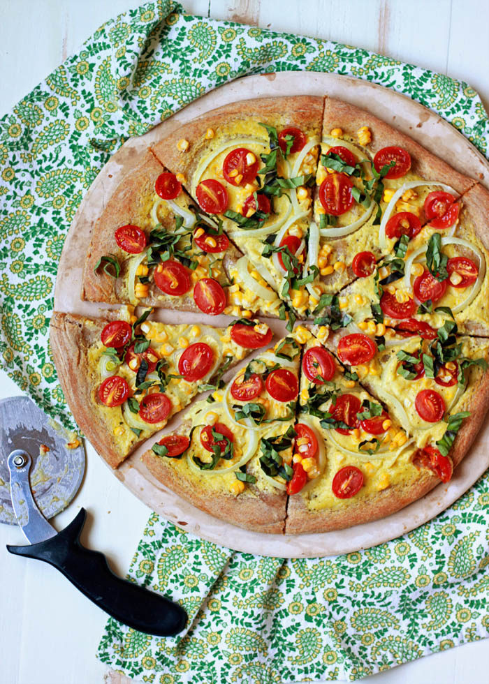 Vegan Summer Pizza with Sweet Corn, Tomatoes, and Basil - Pizza without cheese? Believe it or not, it can be utterly delicious! This summertime pizza with its creamy, garlicky sauce and peak-season produce is proof.