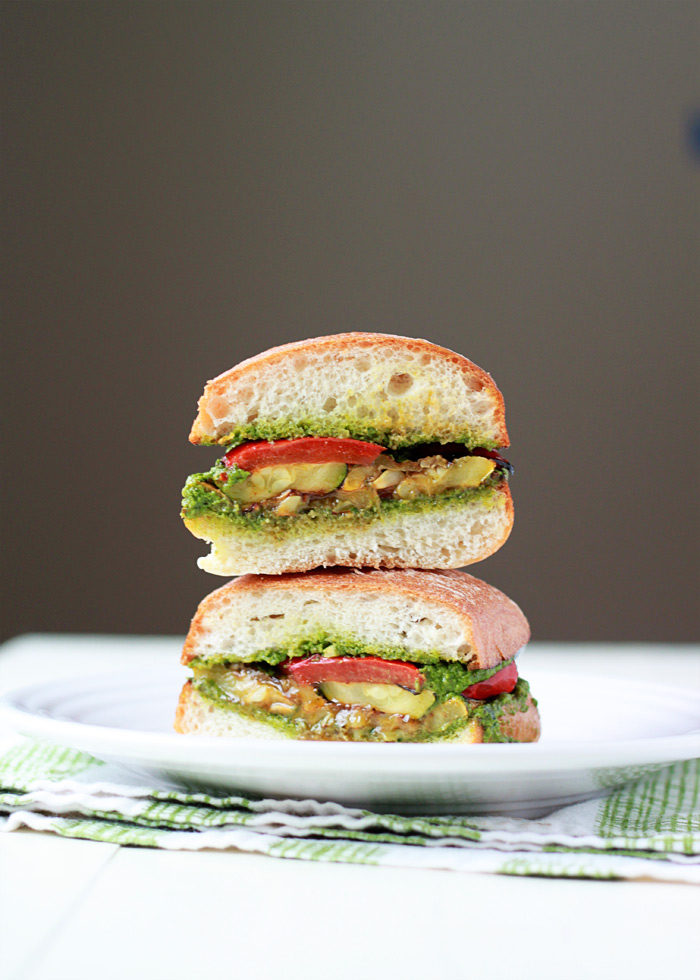 Grilled Summer Vegetable Sandwiches with Pesto - Summer in a vegan sandwich! Zucchini, summer squash, and red bell pepper doused in balsamic-thyme marinade, grilled to perfection, and then piled onto pesto-smeared artisan rolls.