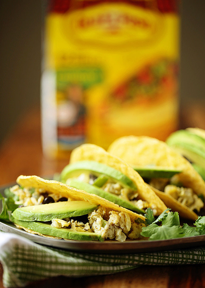 Scrambled eggs flecked with veggies and black beans, stuffed into a crunchy taco shell and topped with creamy avocado. These grab-and-go breakfast tacos are ready in 10 minutes flat! Gluten-free, dairy-free, and vegetarian (but with options for everyone!) Sponsored by @oldelpaso.
