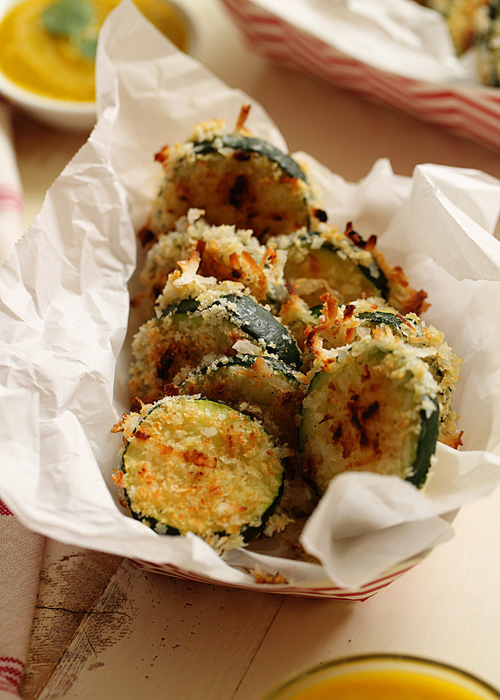 Seriously nosh-worthy, this recipe for Crispy Baked Coconut Zucchini gives zukes a tropical twist. That irresistible Mango-Jalapeno Dipping Sauce seals the deal.