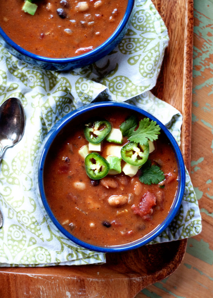 Jalapeno Black Bean and White Bean Soup - This super-simple recipe is healthy, comes together in a cinch, and is so wonderfully full-flavored. We love it! This recipe starts out vegan, but you can customize the toppings to add dairy or even a little meat if the carnivores like.