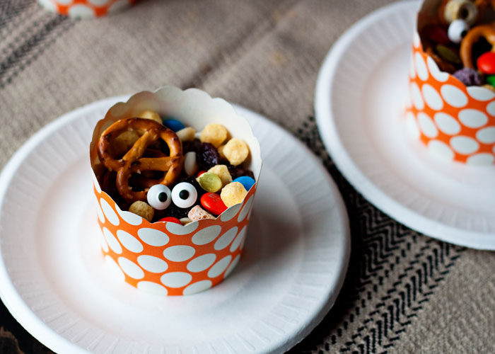 Make-a-Monster Trail Mix - Googly eyes, cereal eyeballs, raisin noses, pretzel heads ... they'll love creating creatures with this ghoulishly simple Halloween kids' snack and activity rolled into one.