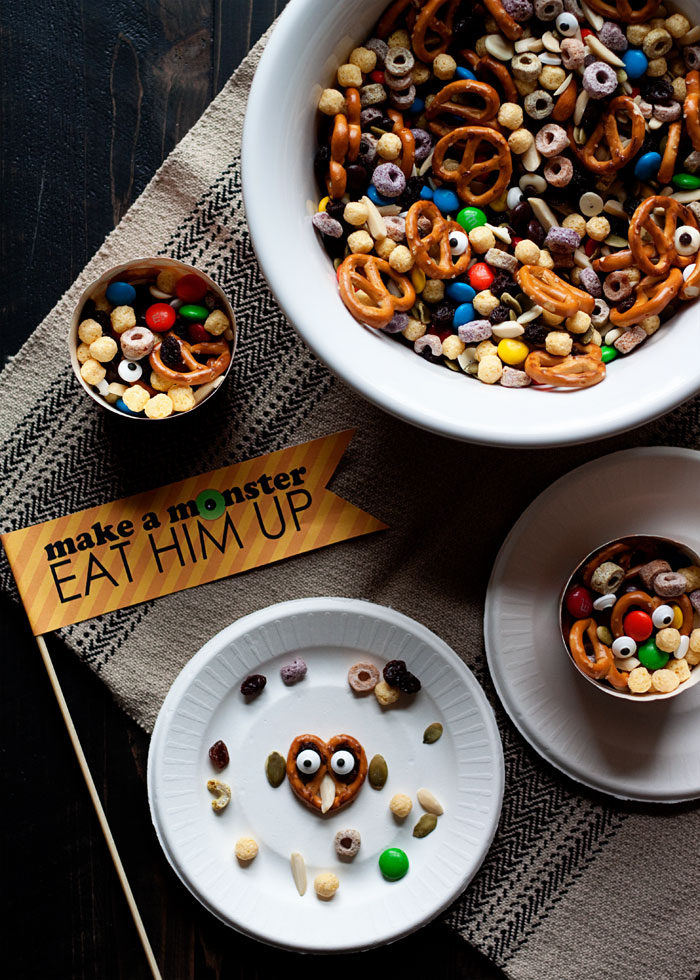 Make-a-Monster Halloween Snack Mix is a huge hit at classroom parties! Make a monster; eat him up. Free printable sign, too!