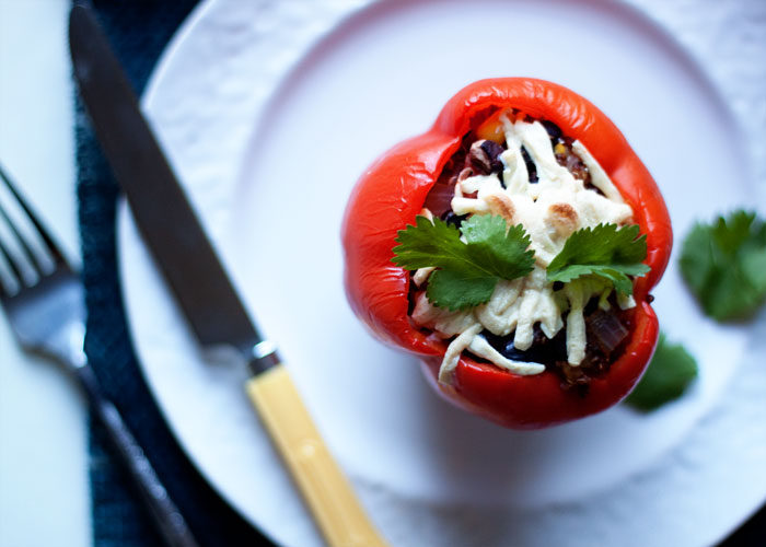 Southwestern Black Bean & Quinoa Stuffed Peppers recipe - Sweet bell peppers, stuffed with southwestern-inspired goodness. This incredibly versatile dinner can be customized for vegetarians, vegans, and meat-eaters alike.